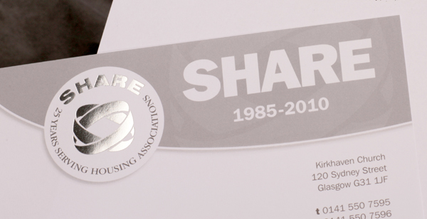 Picture shows top corner of the SHARE 25th Anniversary letterhead, a grey-on-white design featuring a silver metallic foil-blocked logo.