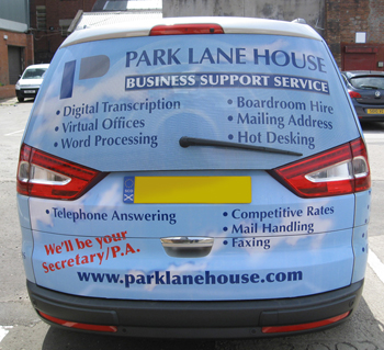 Rear view of vehicle wrap graphics on a silver Ford Galaxy. This view shows a blue clouds and sky theme with text and logo about a business support service in Glasgow.