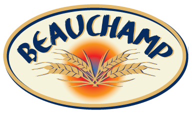 The Beauchamp bread logo looks like an elliptical plaque. Inside the gold edge, there is a cream background with BEAUCHAMP in navy blue type on a curve at the top. Below, four ears of wheat are shown in front of a orange-red-blue circular glow.