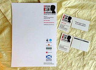 This photo shows business stationery – A4 letterhead and two types of business card – printed with Speak Out Scotland's new brand identity.